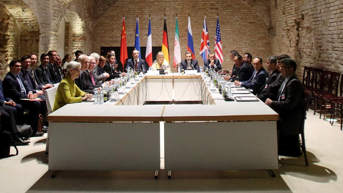 Negotiators of Iran and six world powers face each other at a table in the historic basement of Palais Coburg hotel in Vienna April 24, 2015. Nuclear talks are making good but slow progress as they work towards a June 30 deadline for a final deal, Tehran's senior negotiator Abbas Araqchi said on Friday. REUTERS/Heinz-Peter Bader