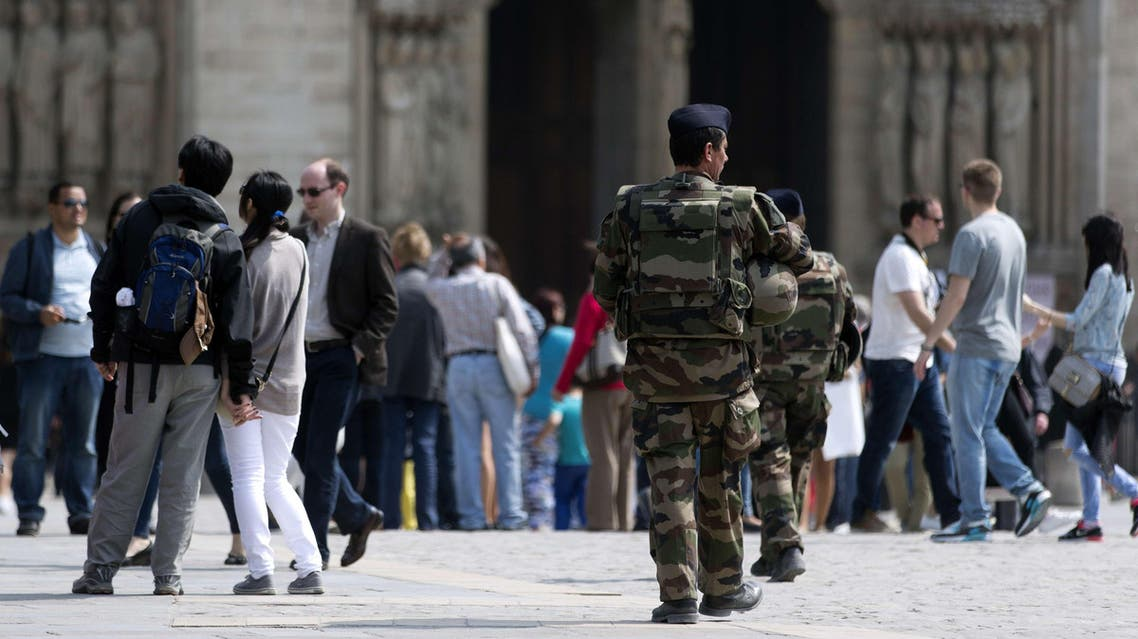 "French soldiers patrol near the Notre-Dame cathedral in Paris on April 24, 2015. Sid Ahmed Ghlam, 24, was being questioned for a fifth day after his custody was extended under special French anti-terror laws which allow police to interrogate a suspect for up to six days if there is a ""risk of an imminent attack"".Paris is still on high alert after the jihadist killing spree on Charlie Hebdo magazine and other targets around Paris that left 17 people dead, and in the wake of a foiled plot to carry out attacks on churches, Interior Minister Bernard Cazeneuve has ordered authorities to step up security around churches. AFP PHOTO KENZO TRIBOUILLARD"