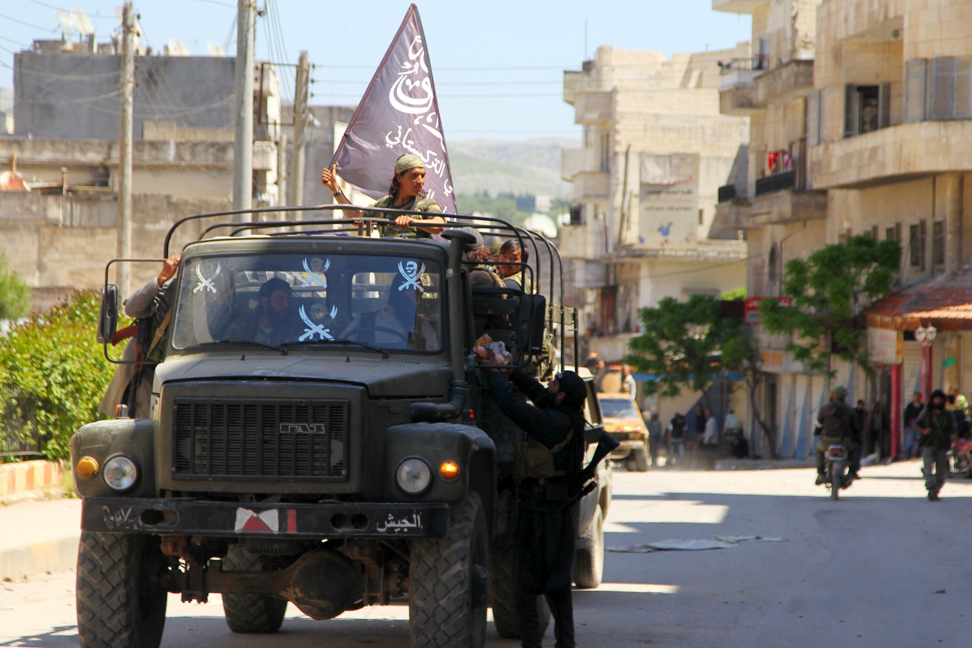 Nusra Front fighters ride a military vehicle that they seized from forces loyal to Syria's president Bashar Al-Assad in Jisr al-Shughour town after rebels took control of the area April 25, 2015. Reuters