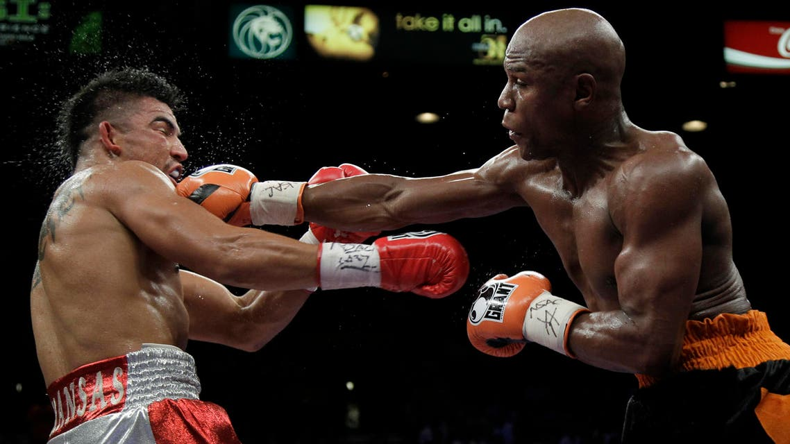 Floyd Mayweather Jr. hits Victor Ortiz Floyd during their WBC welterweight title fight Saturday, Sept. 17, 2011, in Las Vegas. (AP)