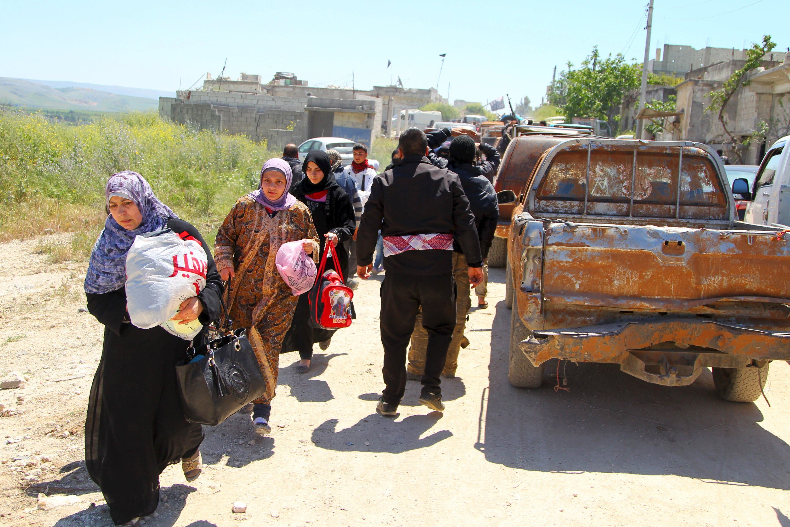 Residents flee Jisr al-Shughour town after rebels took control of the area April 25, 2015. Reuters