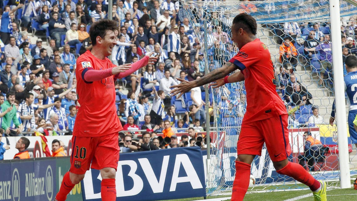 Barcelona's Lionel Messi celebrates his goal against Espanyol with teammate Neymar during their Spanish first division soccer match at Power8 stadium in Cornella de Llobregat near Barcelona. Reuters