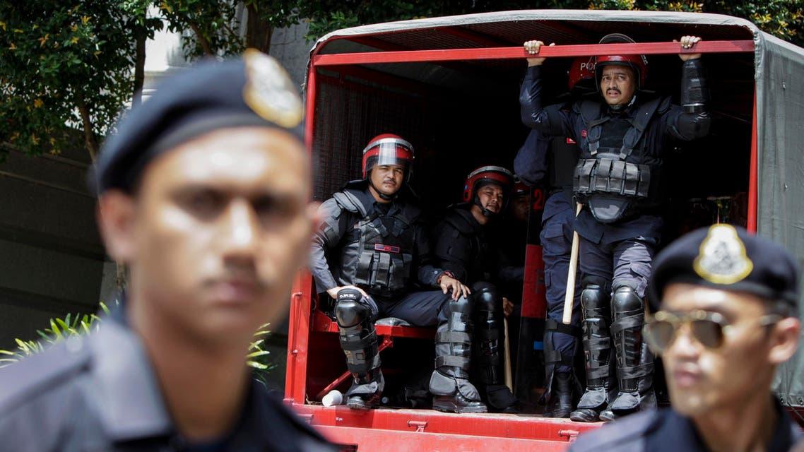 Malaysian police (AP)