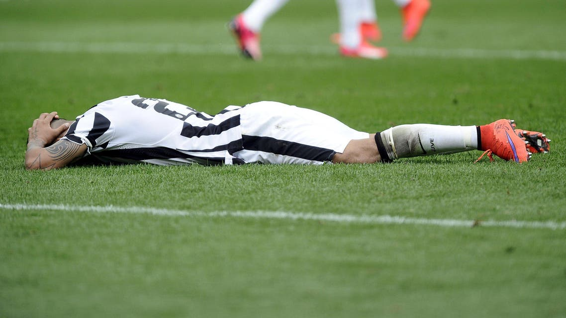 Juventus' Arturo Vidal reacts as he lies on the pitch during their Italian Serie A soccer match against Torino in Turin Reuters