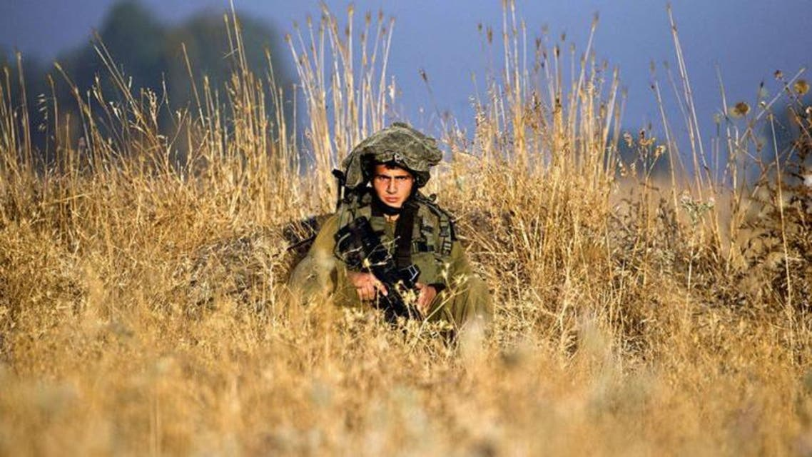 Israeli soldiers from the Golani Brigade take part in a military exercise in the Israeli-annexed Golan Heights near the border with Syria. (AFP)