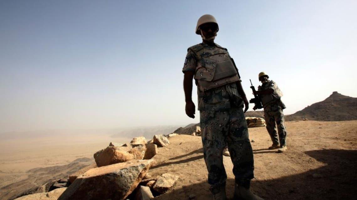 Saudi soldiers stand alert at the border with Yemen in Najran, Saudi Arabia, Tuesday, April 21, 2015. (AP)