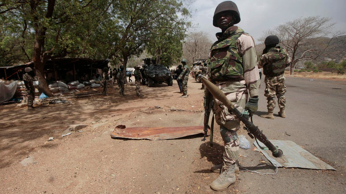 Nigerian Soldiers man a check point in Gwoza, Nigeria, a town newly liberated from Boko Haram. AP