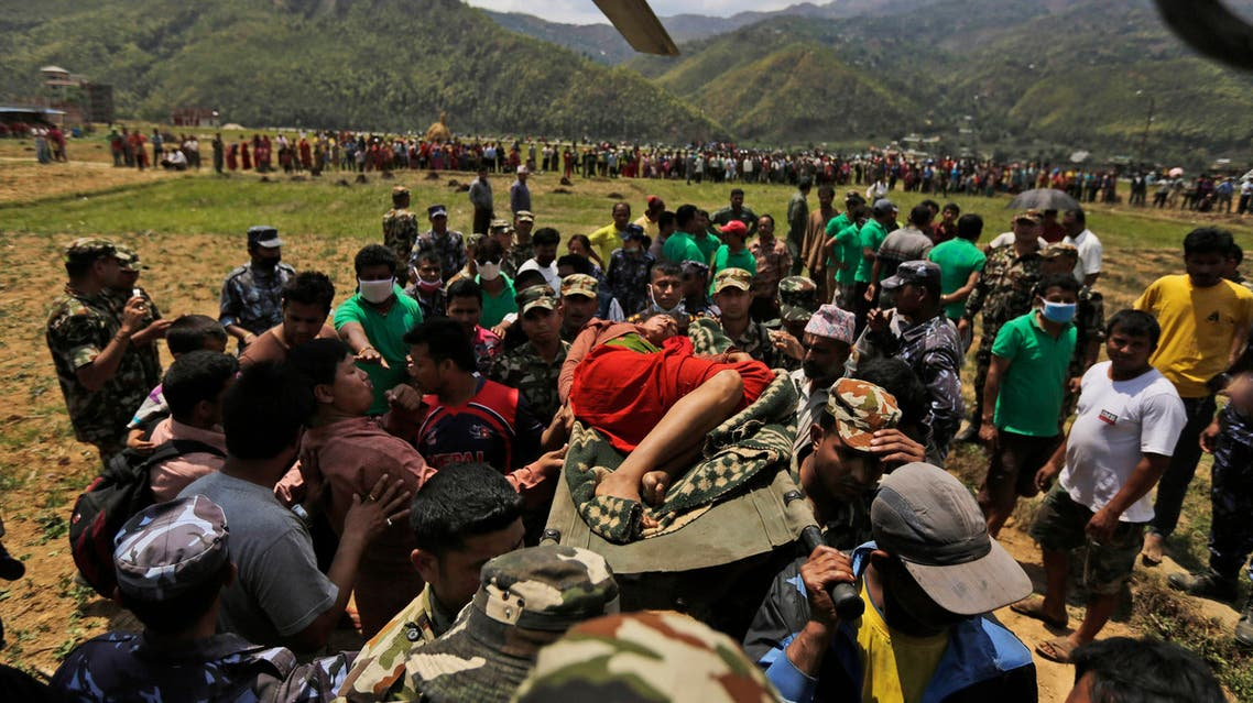 Nepalese soldiers carry a wounded woman to a waiting Indian air force helicopter as they evacuate victims of Saturday's earthquake from Trishuli Bazar to Kathmandu airport in Nepal, Monday, April 27, 2015. AP