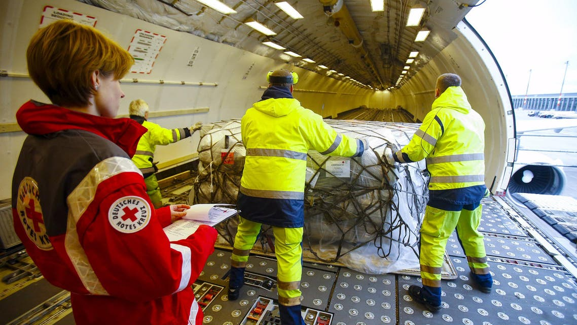 Workers load humanitarian aid from German Red Cross (DRK) for victims of the earthquake in Nepal, into an aircraft at Schoenefeld airport outside Berlin Reuters