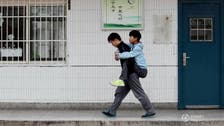 'Beautiful student' in China carries disabled friend to class for 3 years