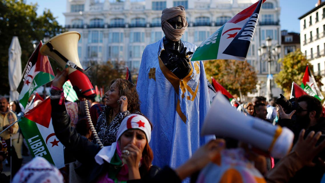 A woman from Western Sahara shouts slogans next to a monument dressed with traditional Western Sahara's outfit in support of Free Western Sahara during a protest in Madrid, Saturday, Nov. 9, 2013. (File Photo:AP)