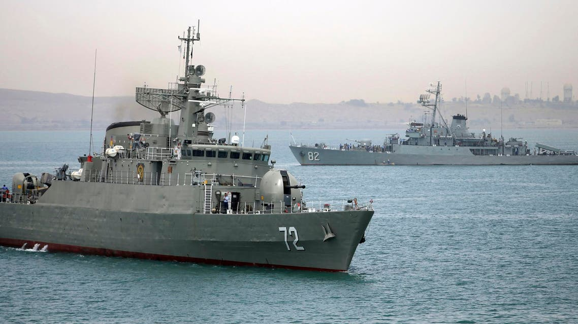 In this picture taken on Tuesday, April 7, 2015, and released by the semi-official Fars News Agency, Iranian warship Alborz, foreground, prepares before leaving Iran's waters. re
