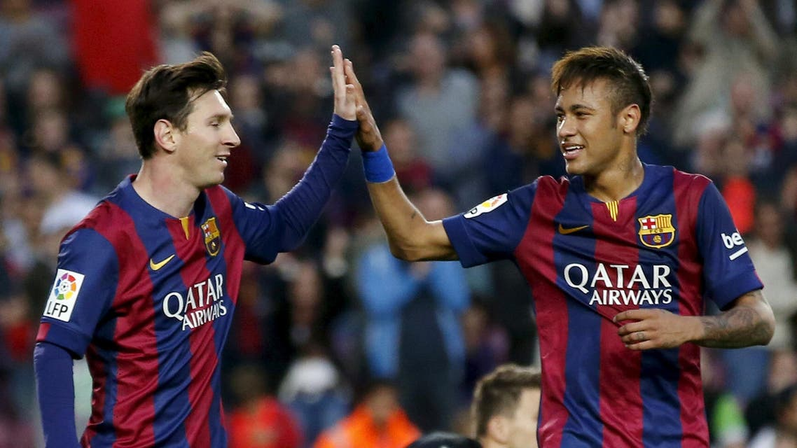 Barcelona's Lionel Messi and Neymar celebrates Xavi Hernandez's goal against Getafe during their Spanish first division soccer match at Nou Camp stadium in Barcelona. Reuters