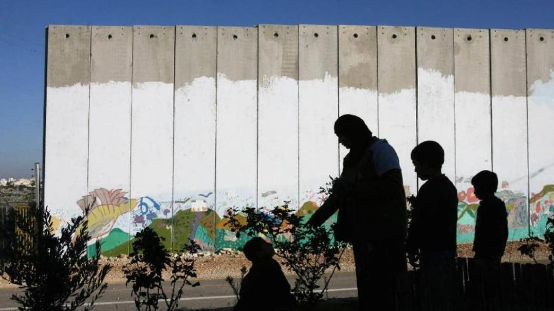 The separation barrier is a vast structure, most of it built inside the occupied West Bank, that divides Israel and its main settlement blocs from the rest of the territory  AFP