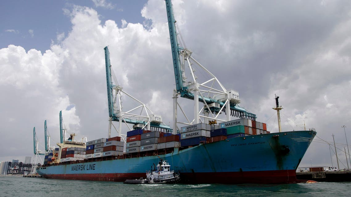 A Maersk freighter is loaded with shipping containers at the Port of Miami in Miami, Friday, May 18, 2012. (AP)