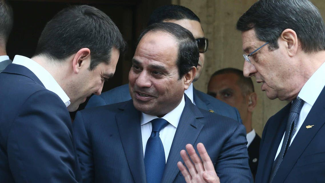 Cypriot President Nicos Anastasiades (R), Greek Prime Minister Alexis Tsipras (L) and Egyptian President Abdel Fattah al-Sisi speaking following a joint press conference at the Presidential Palace in Nicosia on April 29, 2015. (AFP)