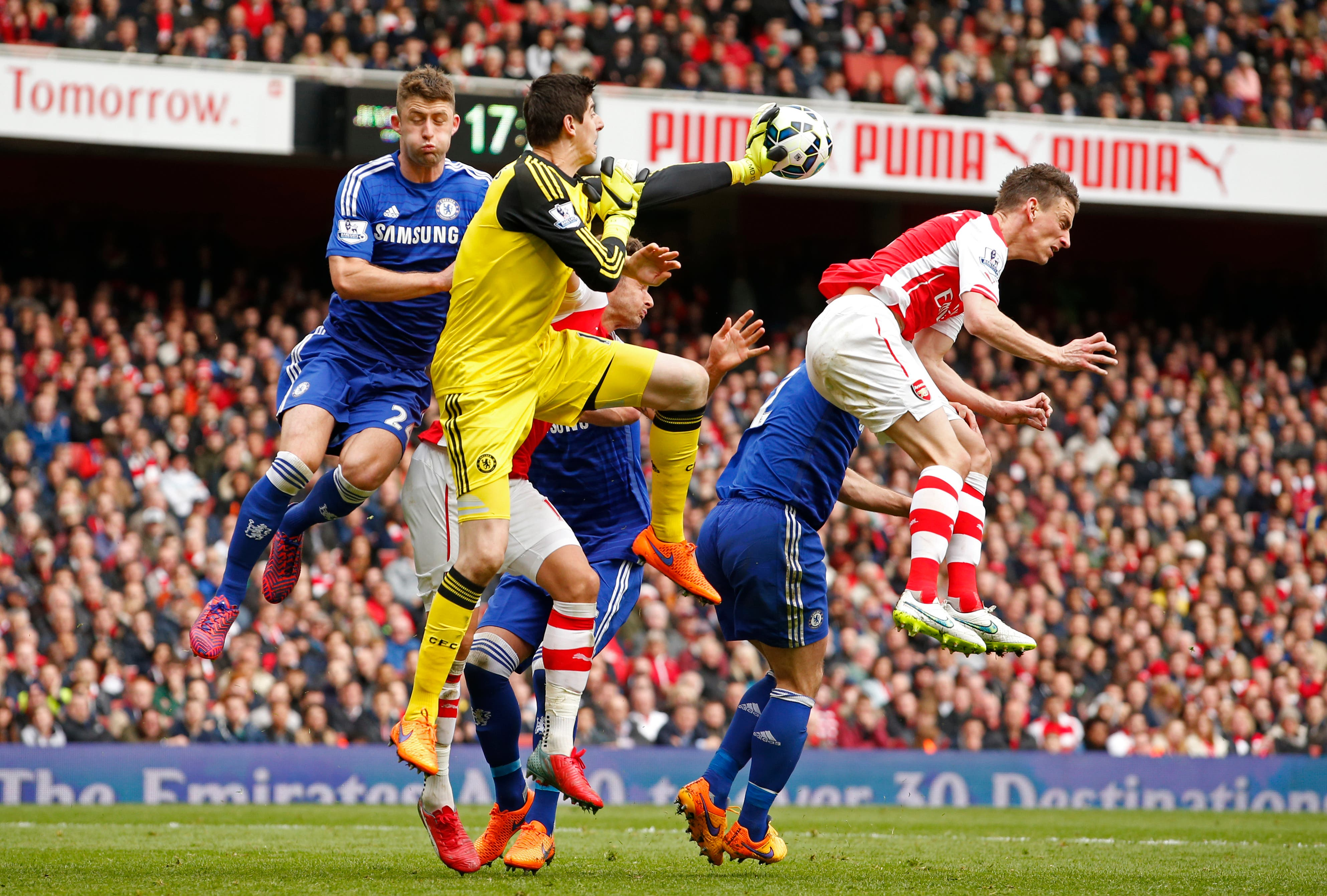Chelsea's Thibaut Courtois and Gary Cahill in action with Arsenal's Laurent Koscielny Action Images via Reuters / John Sibley