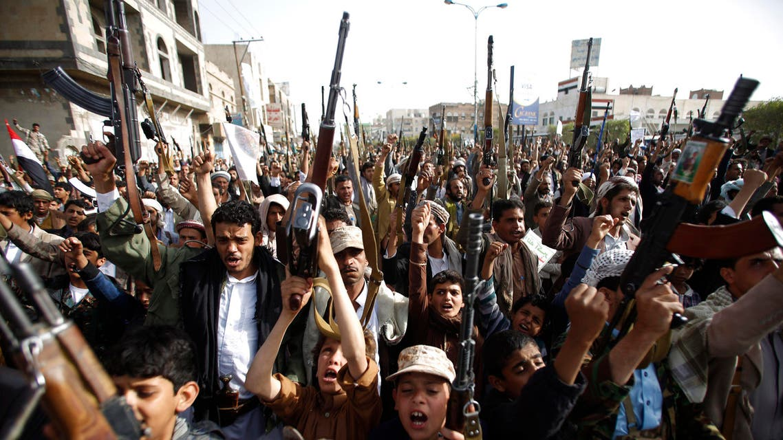 Houthis hold up their weapons to denounce the Saudi-led airstrikes as they chant slogans during a protest in Sanaa, Yemen, Monday, April 27, 2015. (Reuters)