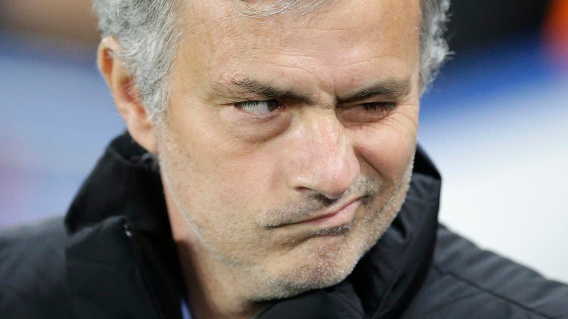 Chelsea manager Jose Mourinho grimaces before before the Champions League round of 16 second leg soccer match between Chelsea and Paris Saint Germain at Stamford Bridge stadium in London, Wednesday, March 11, 2015. (AP Photo/Matt Dunham)