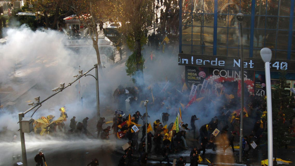 Riot police use water cannons and pepper gas to disperse thousands of Turkish teachers who were gathered to protest against the government's education and economic policies in Ankara, Turkey, Saturday, Nov. 23, 2013.(AP Photo)