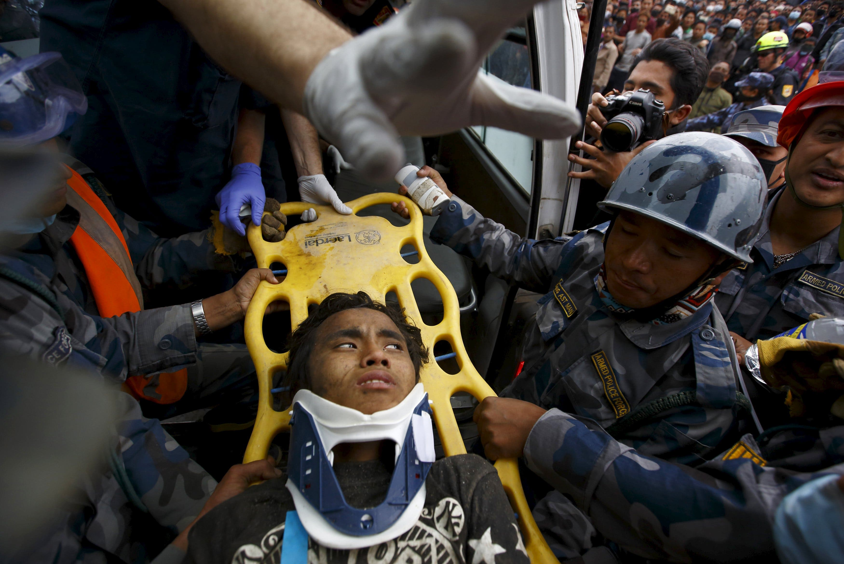 Earthquake survivor Pema Lama, 15, is rescued by the Armed Police Force from the collapsed Hilton Hotel, a result of an earthquake in Kathmandu, Nepal April 30, 2015. (Reuters)