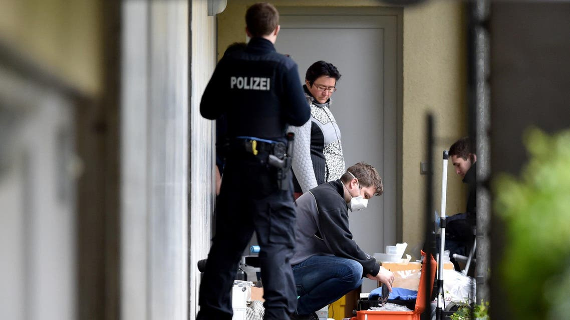 Experts from the police secure evidence in an apartment complex on April 30, 2015 in Oberursel, western Germany. (AFP)