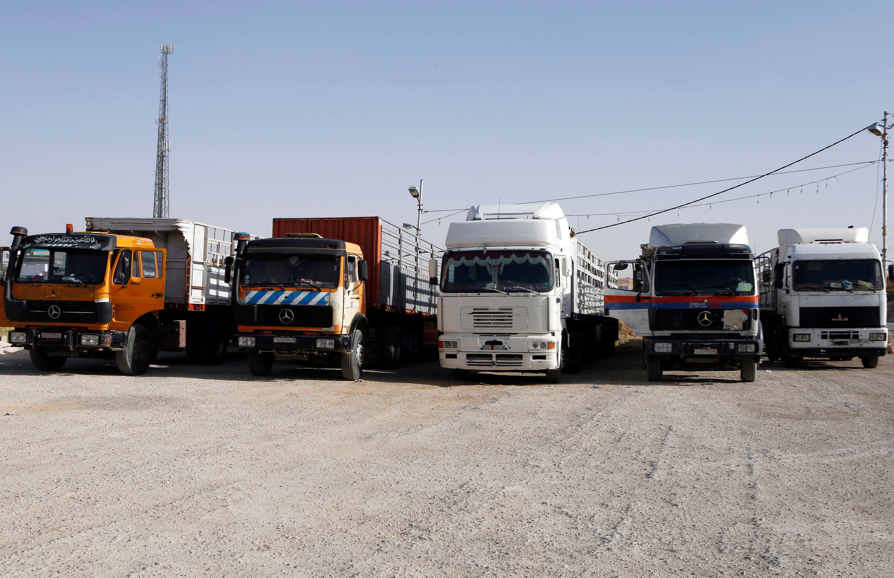 In this picture taken on Sunday, April 26, 2015, Jordanian trailer trucks sit idle at Jaber border crossing between Jordan and Syria north of Mafraq, Jordan. Jordan's overland trade has largely been paralyzed by recent border attacks from insurgents in neighboring Syria and Iraq - a spillover of regional turmoil threatening a close Western ally that has thus far succeeded in fending off Islamic militants. (AP Photo/Raad Adayleh)