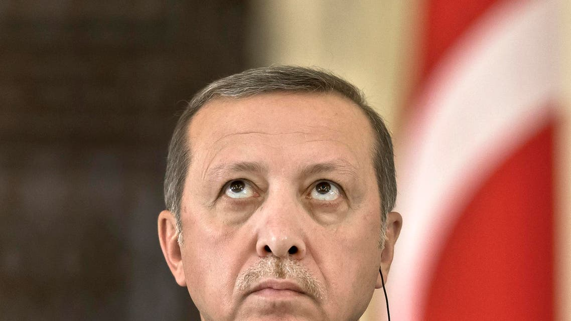Turkish President Recep Tayyip Erdogan looks up during a press conference at the Cotroceni presidential palace in Bucharest, Romania, Wednesday, April 1, 2015. Two members of a banned leftist group and a prosecutor they held hostage inside a courthouse in Istanbul died Tuesday after a shootout between the hostage takers and police, officials said. Erdogan is on an official visit to Romania. (AP Photo/Vadim Ghirda)