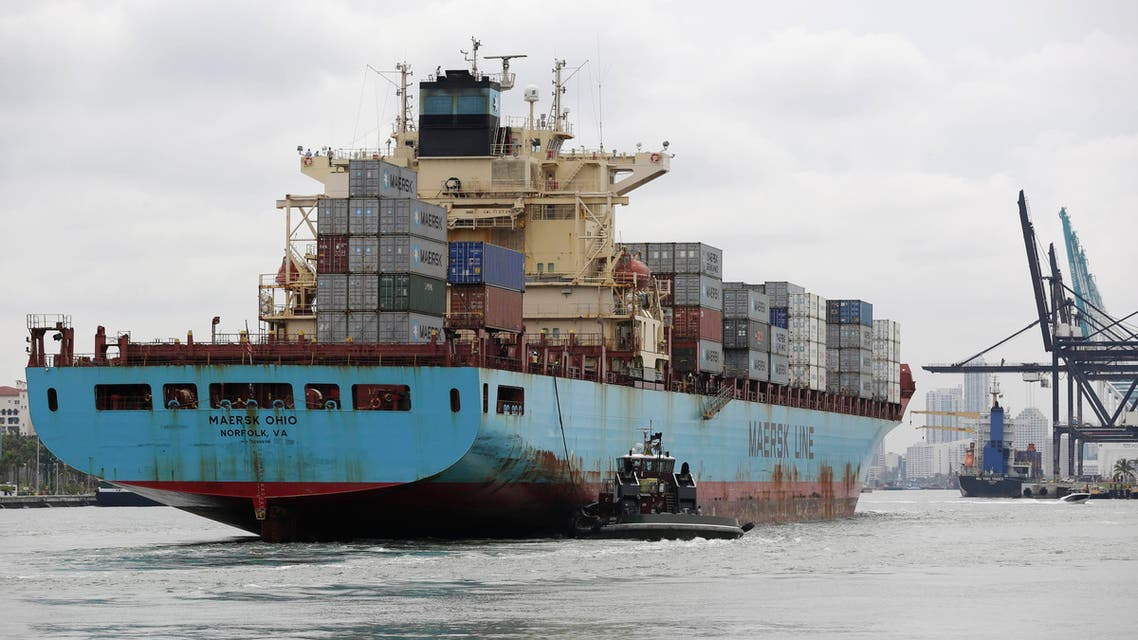 In this Friday, May 16, 2014 file photo, a Maersk Line vessel is guided by a tugboat as it heads into the Port of Miami off of Miami Beach, Fla.  (File photo: AP)