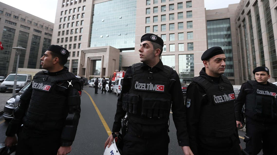 Members of special security forces stand outside the main courthouse in Istanbul, Turkey, Tuesday, March 31, 2015.  (AP)