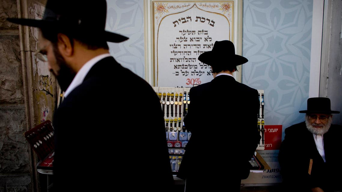 Ultra-orthodox Jewish men shop before Shabbat in the Mea Sharim neighborhood, Jerusalem, Friday, Nov. 12, 2010.  (AP)