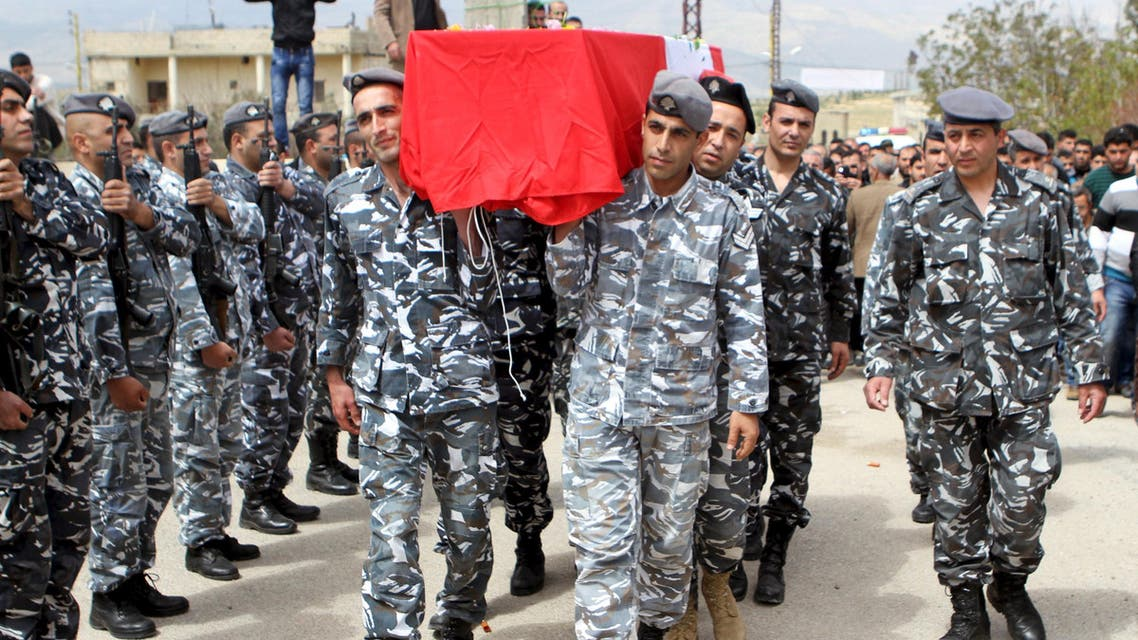 Lebanese security forces carry the coffin of Lebanese soldier Ali al-Bazzal, who was killed by Syria's al Qaeda offshoot Nusra in December, during his funeral after receiving his body in his hometown Bazalia village April 3, 2015.  (Reuters)