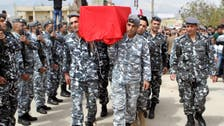 Militants hand over two bodies to Lebanese army