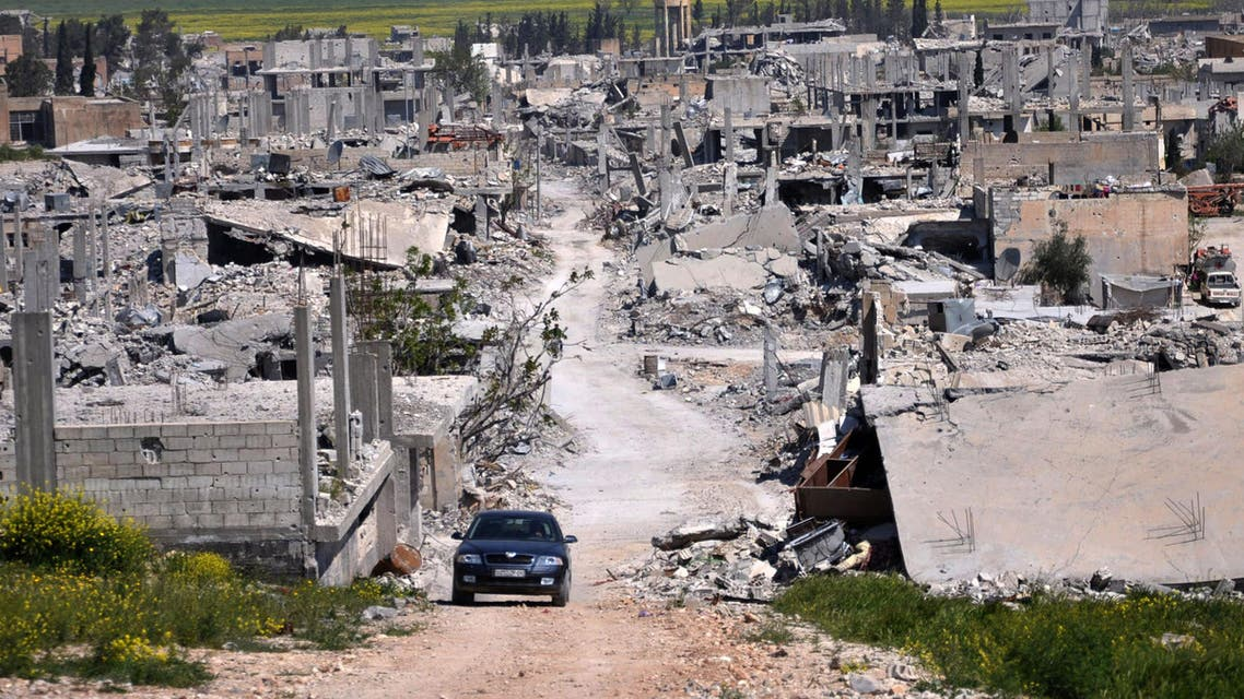 a car passes in an area that was destroyed during the battle between the U.S. backed Kurdish forces and the Islamic State fighters, in Kobani, north Syria. (File: AP)