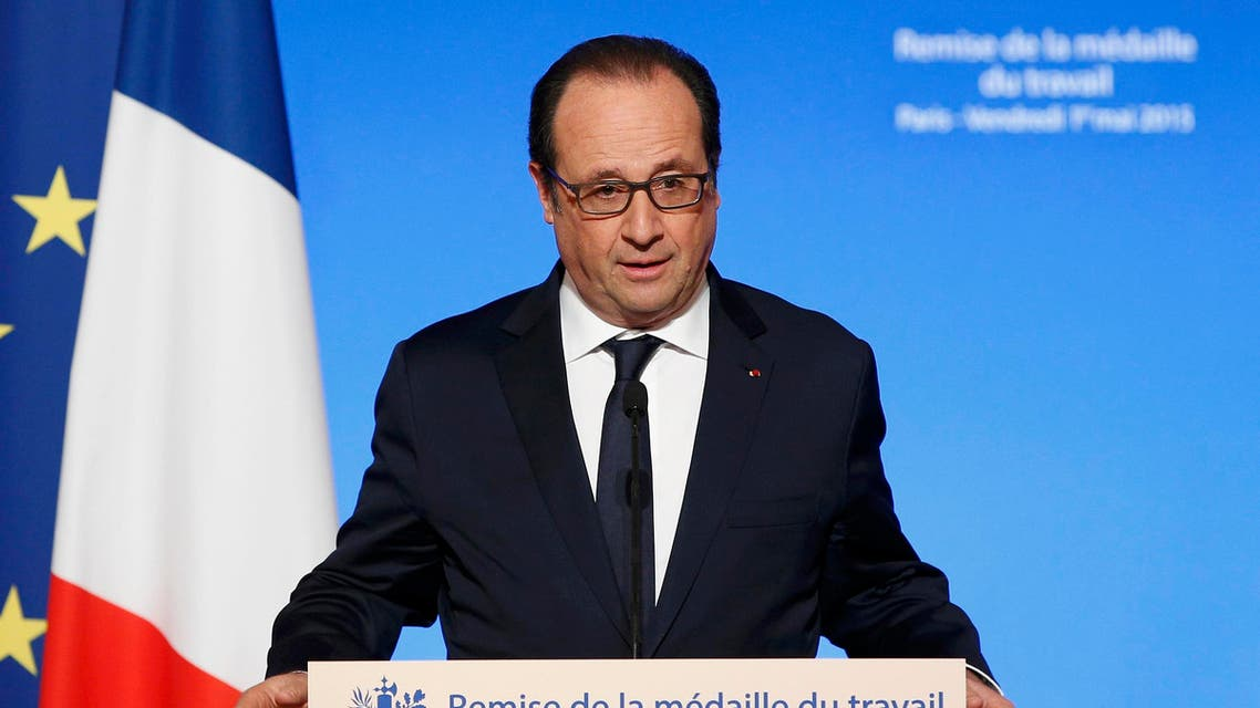 French President Francois Hollande during a Working Medal of Honor awards ceremony on May Day at the Elysee Palace, in Paris, France, May 1, 2015. (Reuters)