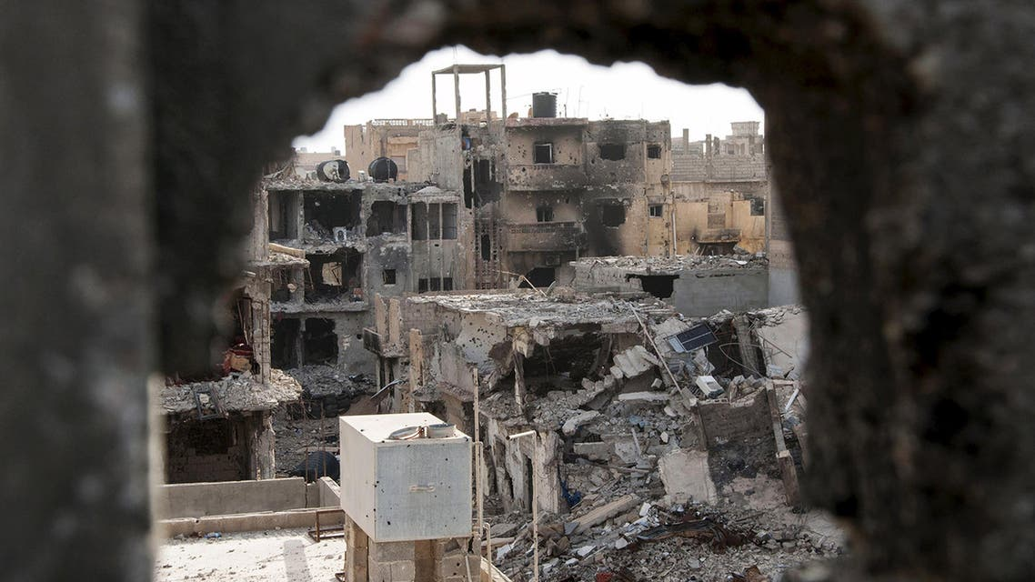 Damaged buildings are pictured after clashes between forces in Benghazi. (File photo: Reuters)