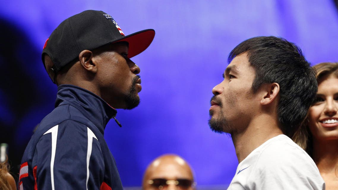 Floyd Mayweather Jr., left, and Manny Pacquiao pose during their weigh-in on Friday, May 1, 2015 in Las Vegas. (AP)