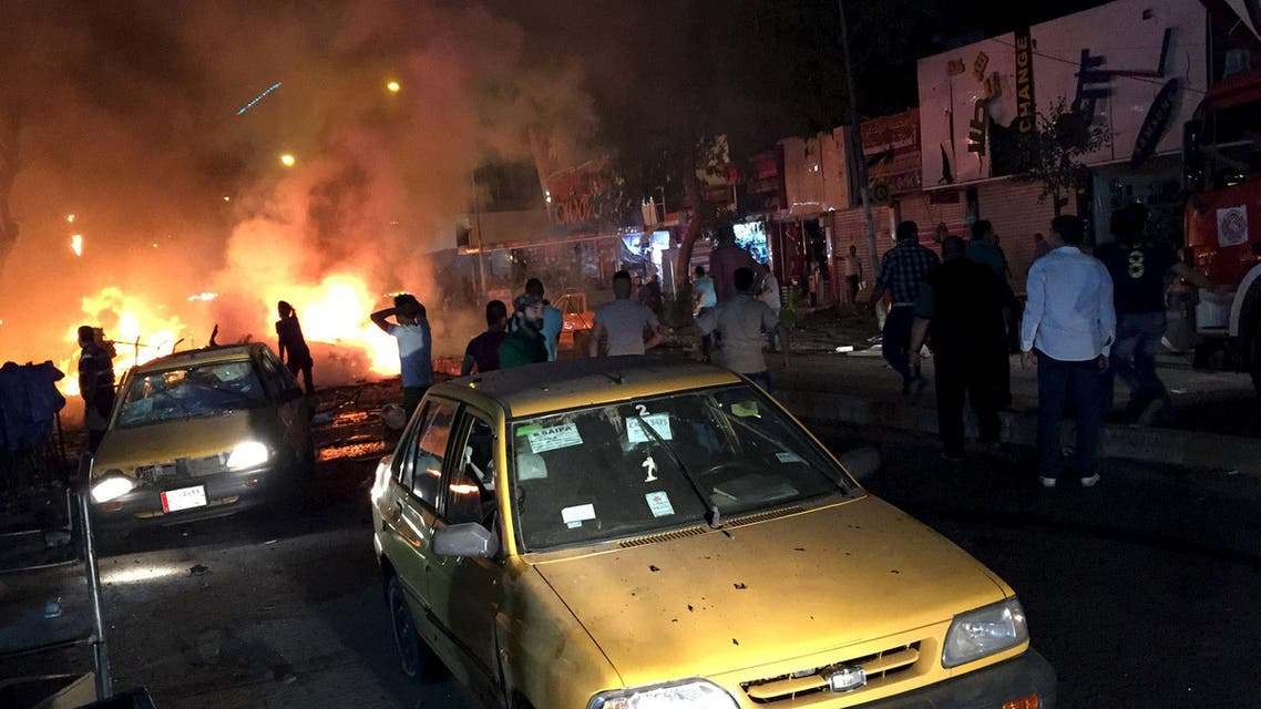 People gather at the site of car bombs attack in Baghdad, May 2, 2015. (Reuters)