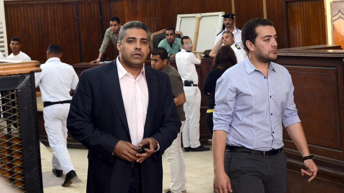 Journalists Mohamed Fahmy (L) and Baher Mohamed are seen at a court in Cairo after their retrial on April 22, 2015. (Reuters)