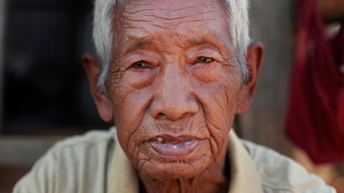 Fattha Bahadur Rana, 90, sits in the rubble of his collapsed home in the destroyed village of Pokharidanda, near the epicenter of the April 25 massive earthquake, in the Gorkha District of Nepal. (AP)