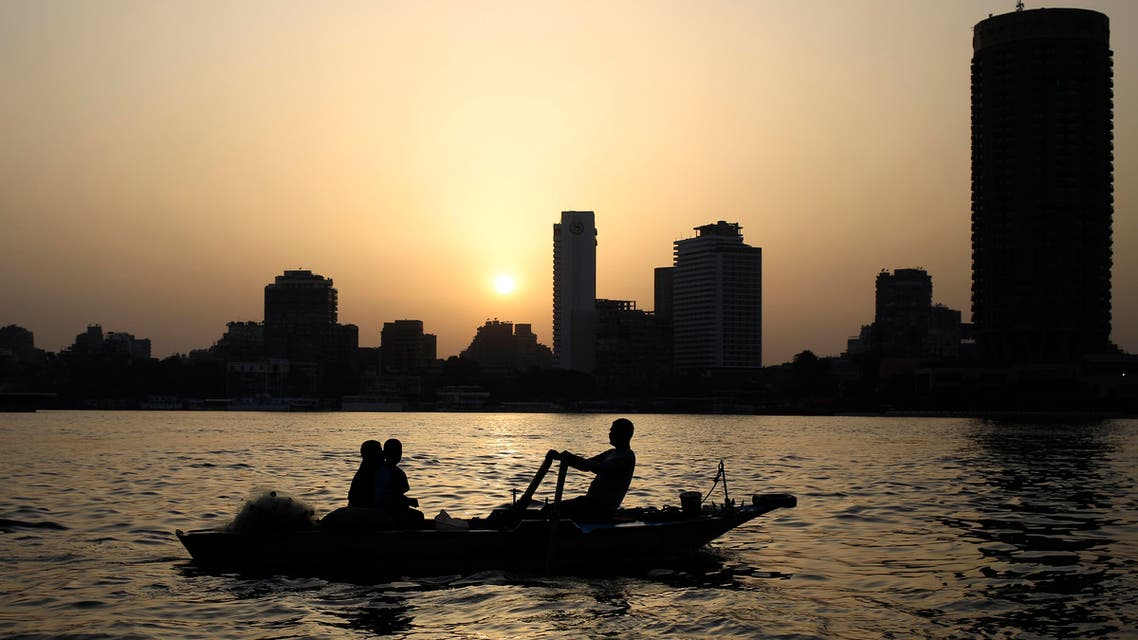 Egyptian fishermen fish on the Nile River as the sun sets in Cairo, Egypt, Tuesday, April 21, 2015.  (AP)