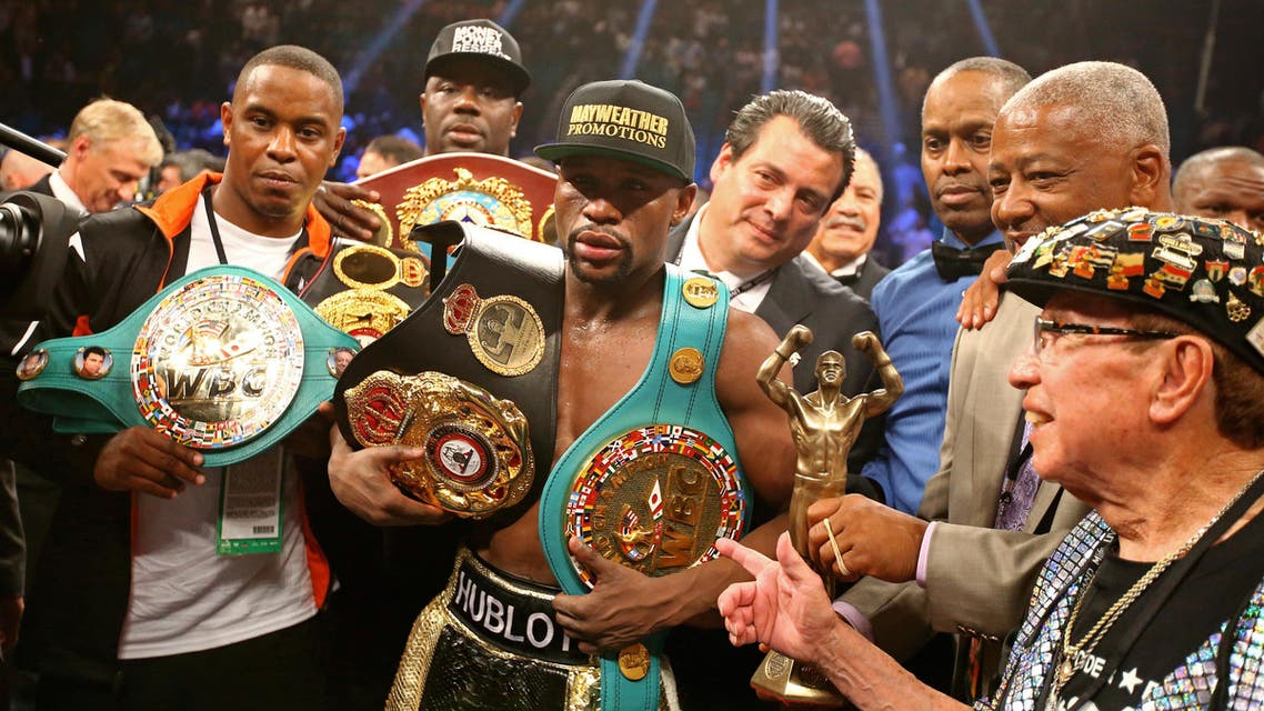 Mayweather danced, ducked and peppered Pacquiao with enough punches to take the decision, while Pacquiao rushed forward