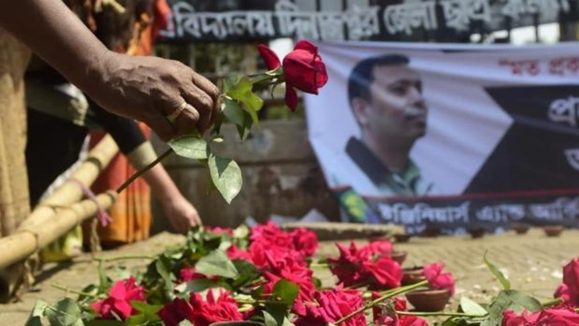 A Bangladeshi social activist pays his last respects to slain US blogger of Bangladeshi origin and founder of the Mukto-Mona website, Avijit Roy in Dhaka in March (AFP)