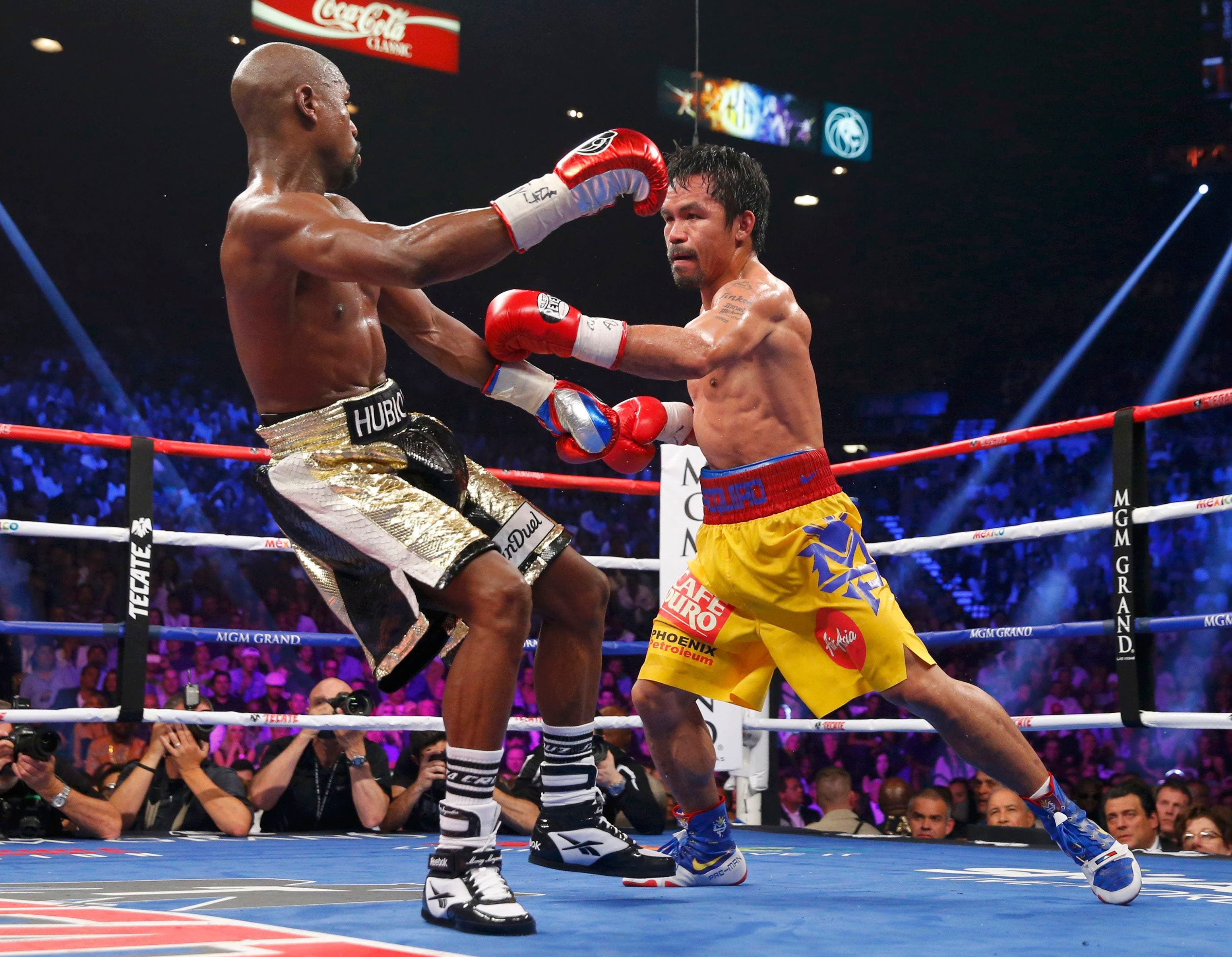 Pacquiao of the Philippines lands a left in the seventh round against Mayweather, Jr. of the U.S. during their welterweight title fight in Las Vegas. (Reuters)