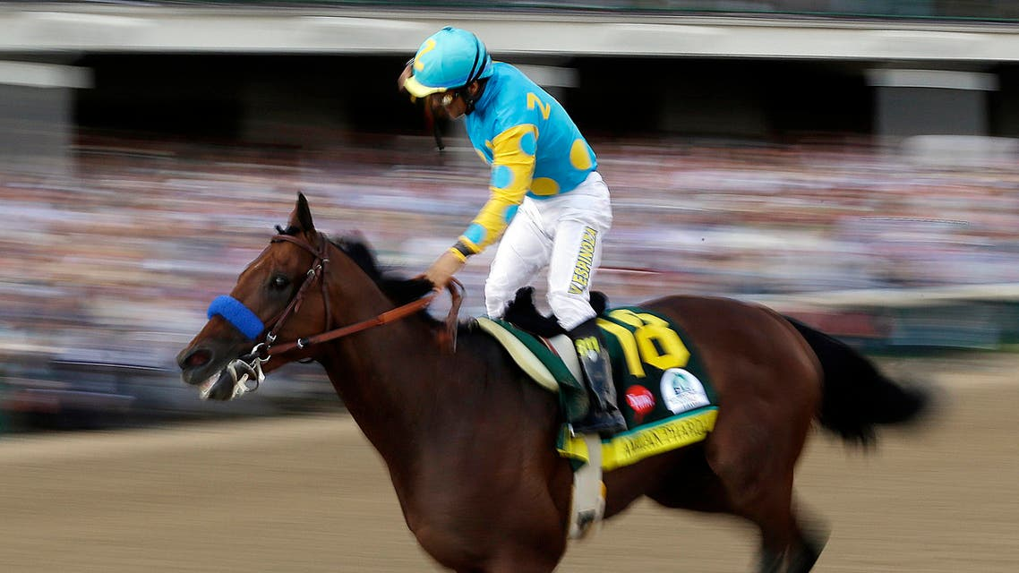 Victor Espinoza rides American Pharoah to victory in the 141st running of the Kentucky Derby horse race at Churchill Downs Saturday, May 2, 2015, in Louisville, Ky. (AP)