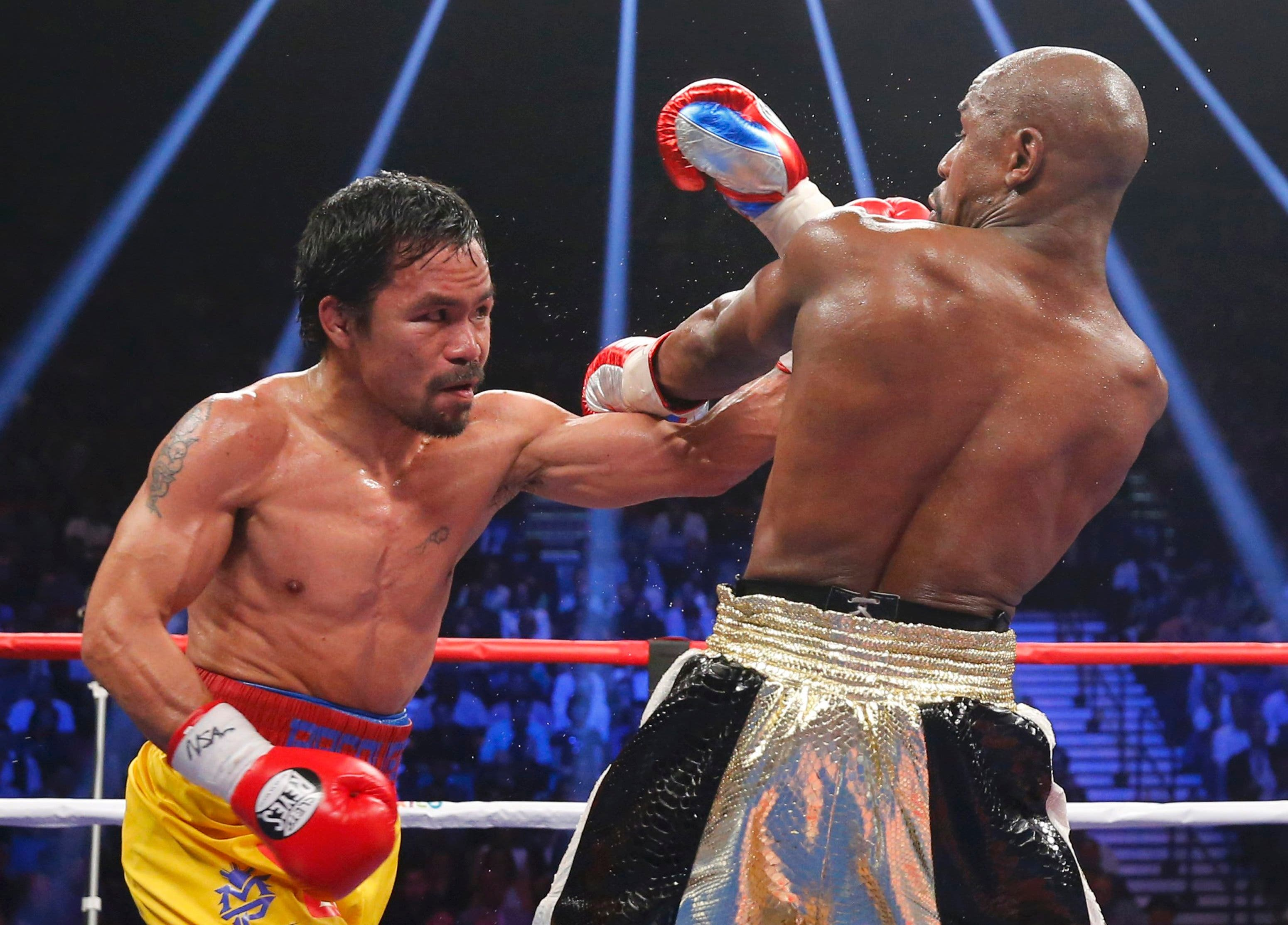 Pacquiao of the Philippines lands a left in the seventh round against Mayweather, Jr. of the U.S. during their welterweight title fight in Las Vegas