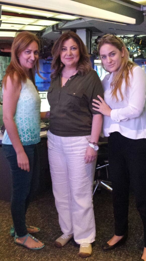 Aznive Tossounian welcomed back to the Al Arabiya newsroom by colleagues. (Supplied)
