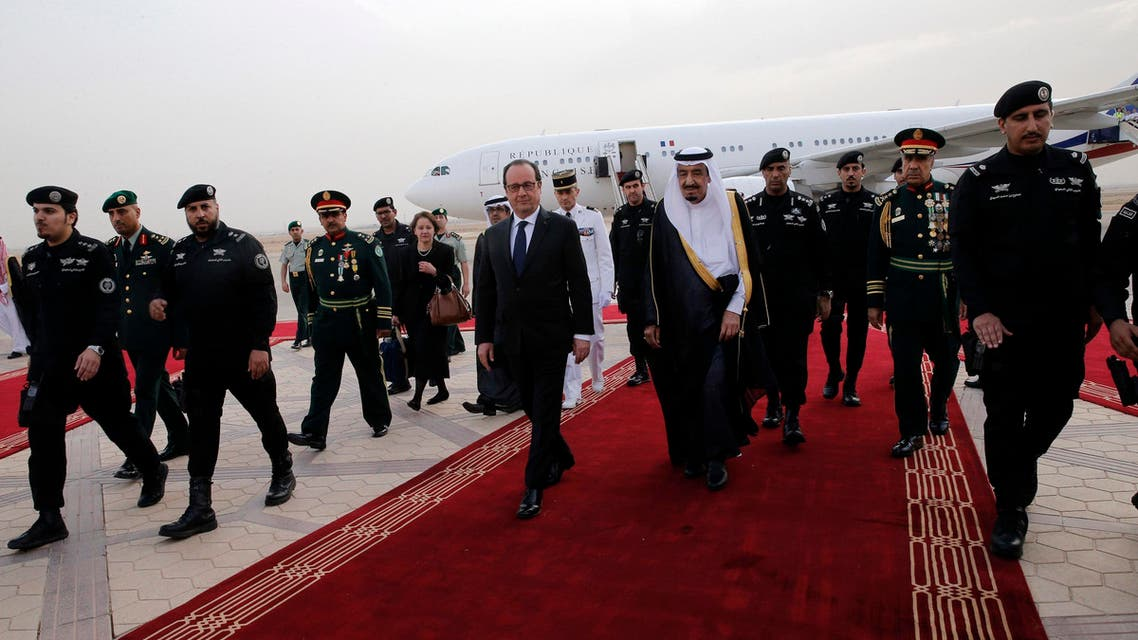 French President Hollande is greeted by Saudi Arabia's King Salman upon his arrival at Riyadh airport - Reuters