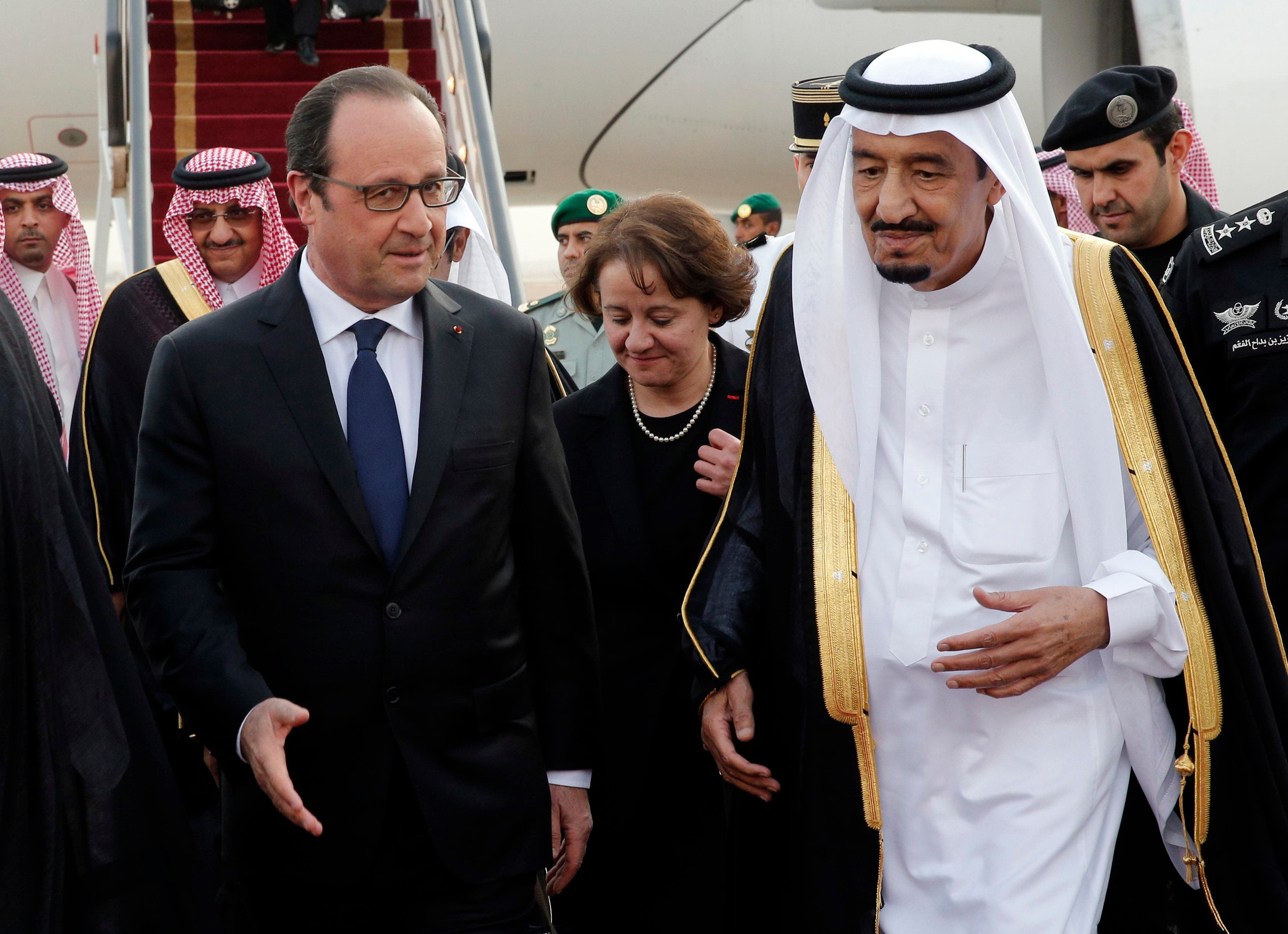 French President Hollande is greeted by Saudi Arabia's King Salman upon his arrival at Riyadh airport Reuters