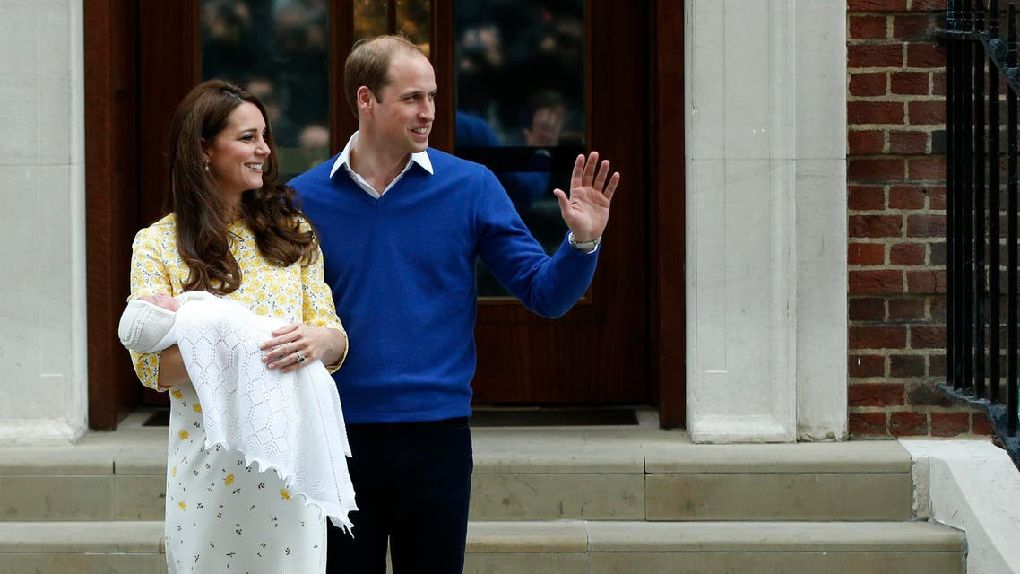 Britain's Prince William, right, and Kate, Duchess of Cambridge, pose for the media with their newborn daughter outside St. Mary's Hospital's exclusive Lindo Wing, London, Saturday, May 2, 2015. (AP)